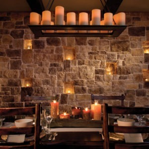 Indoor walls in dining room built with eldorado rough cut autumn leaf stone