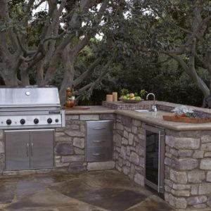 Backyard patio and kitchen area built with eldorado stone
