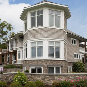 Eldorado stacked stone nantucket facade on bottom portion of home and wall