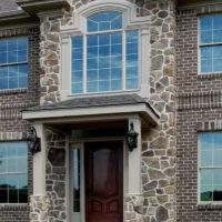 Stonecraft fieldstone bucktown facade on center section of home