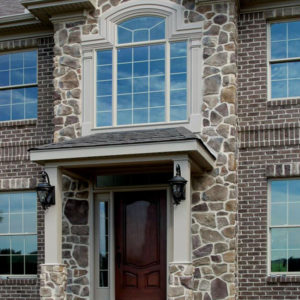 Stonecraft fieldstone bucktown facade on center section of home