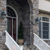 Stonecraft heritage pennsylvania facade around arc of front entrance on home