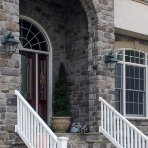 Stonecraft heritage pennsylvania facade around arc of front entrance on home