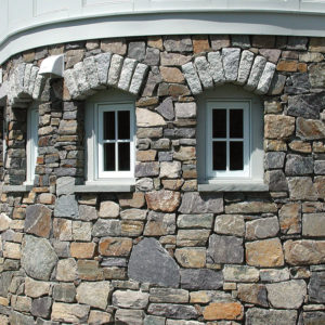 Champlain american granite mosaic wrap around on house