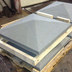 Apex column caps in Thermal Bluestone on a pallet in a stone custom fabrication shop