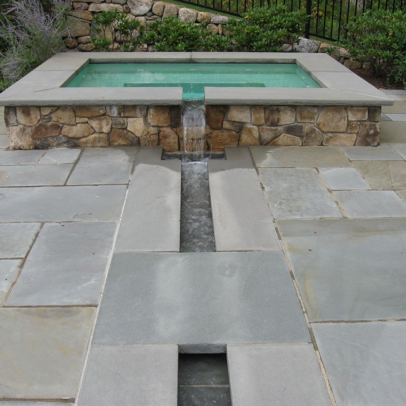 Patio and pool are made out of Bluestone mixed color