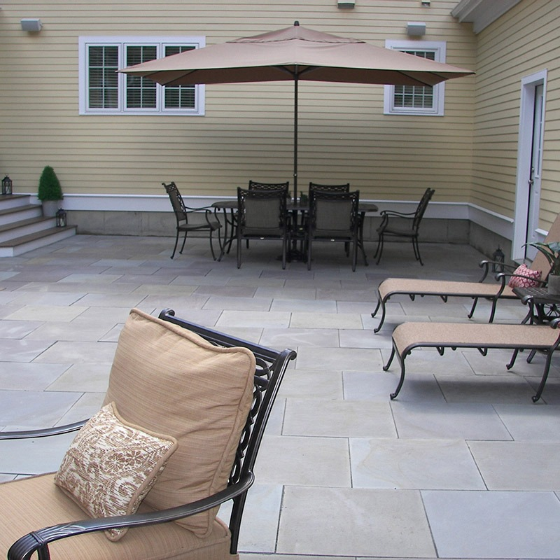 Backyard patio built with thermal blue bluestone