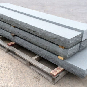 Steps in Thermal Bluestone with rockface edge on a pallet in a stoneyard