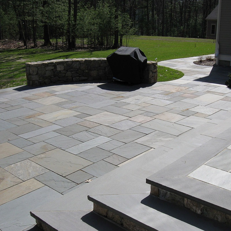 Backyard steps and patio built with bluestone