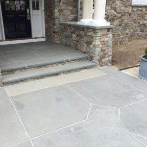 Custom bluestone front entrance walkway and steps