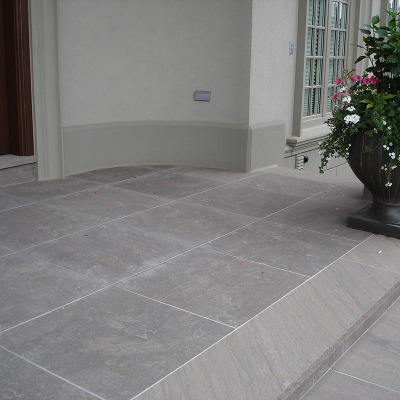 Front of house entrance with brown wave stone
