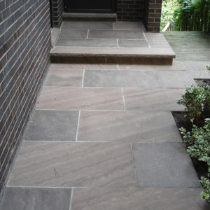 Front of house walkway with brown wave pattern and steps