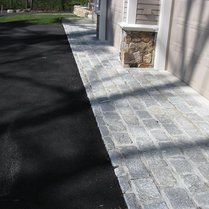 Gray cobblestone in driveway