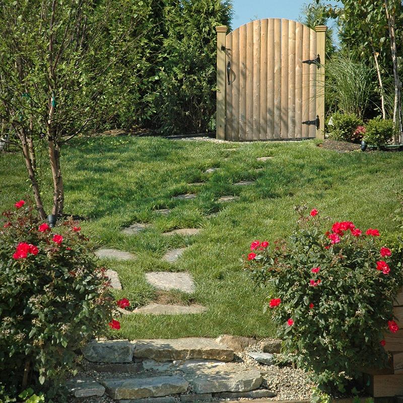 Backyard walkway placed with champlain ticonderoga irregular flagging