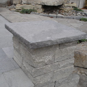 Concrete pillar with custom hampton limestone cap