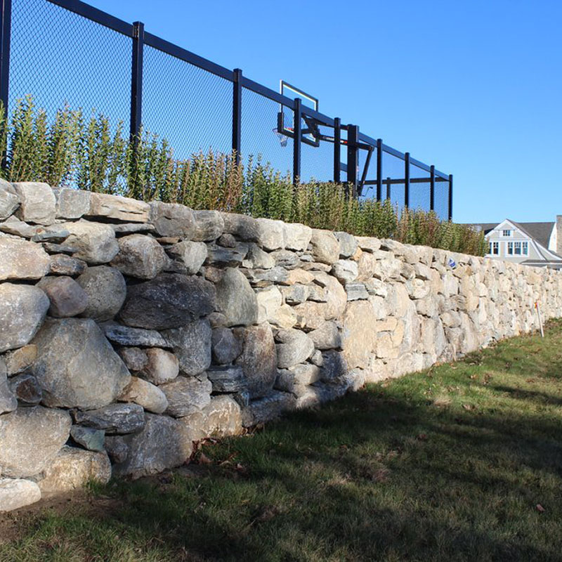 PSW NE fieldstone wallstone along basketball court