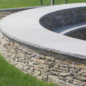 "PSW colonial gray wallstone 1-3"" with bluestone capping"