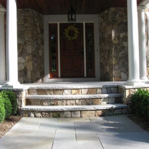 Custom radius salt and pepper steps at front entrance