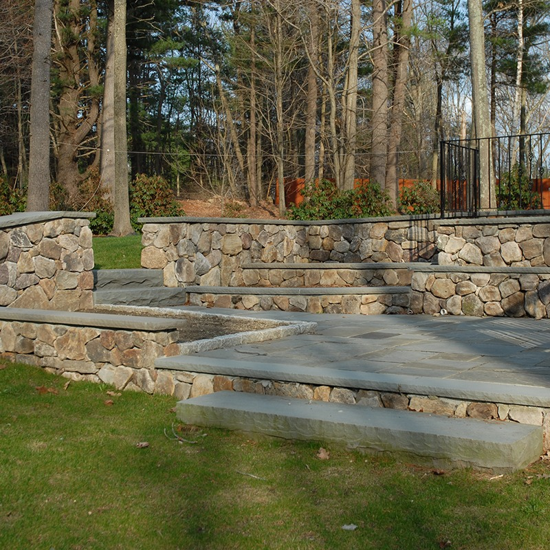 Patio built with PSW natural thin veneer, white mountain round and bluestone