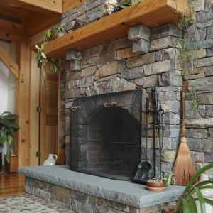 Champlain stone - american granite, ledge stone with bluestone hearth used on fireplace