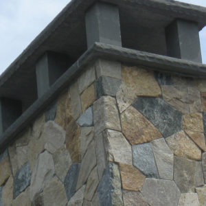 Portland stone ware natural thin veneer - new england blend, mosaic with bluestone cap on chimney