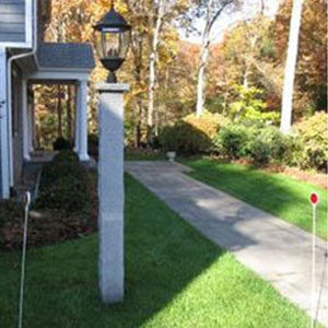 outside of a house showing a lamp post and a walkway