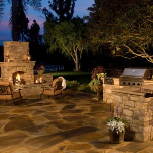 Outdoor gas burning fireplace with Eldorado stone