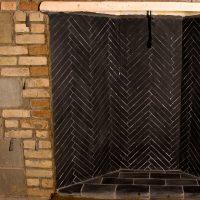 black firebrick in a rumford fireplace