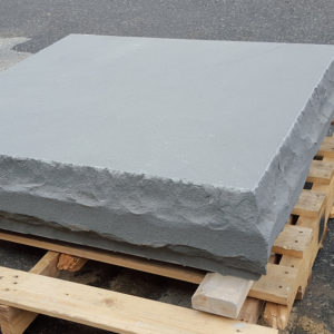 Column cap in Thermal Bluestone with rockface edge on a pallet