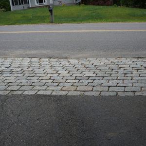 Jumbo cobblestone lining a driveway