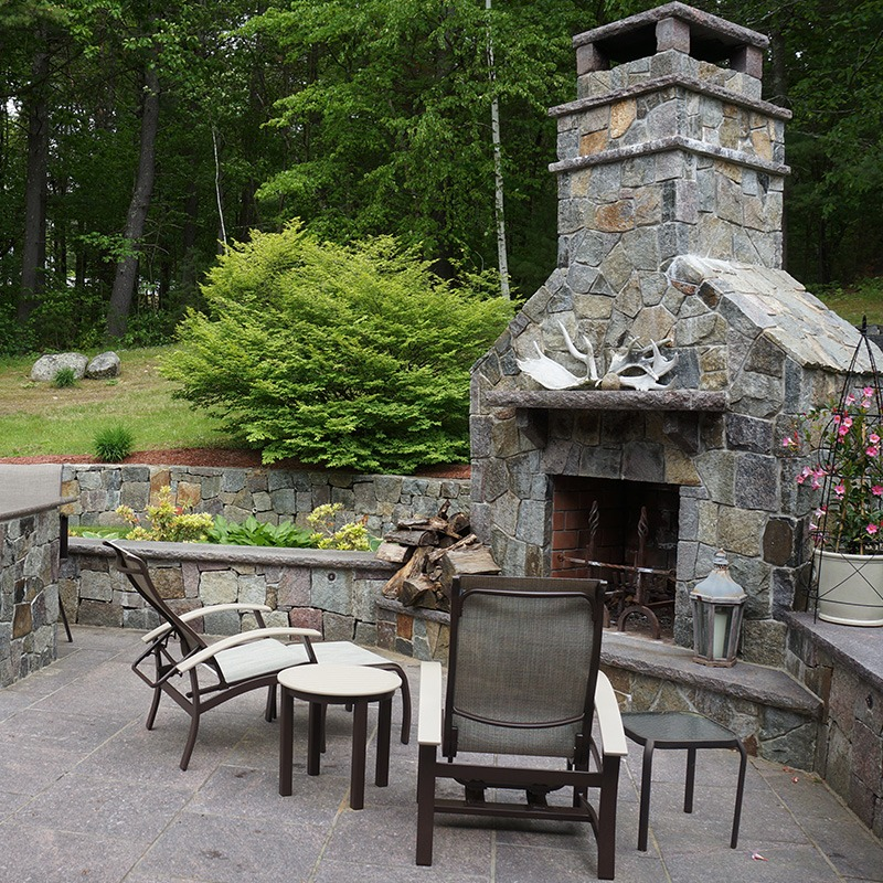 Custom outdoor fireplace with dakota mahogany granite capping