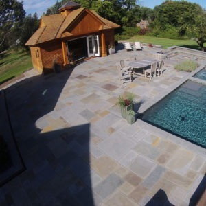 Large pool patio built with bluestone