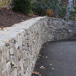 portland stone ware retaining wall along driveway
