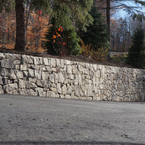 retaining portland stone ware wall along driveway