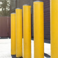 yellow bollards protecting a building