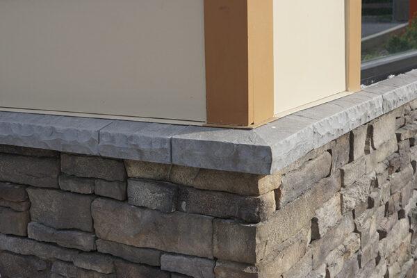 corner of a building with stone and Eldorado Stone accents - wainscott sills and wainscott corner